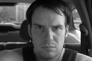 Man with headphones staring
